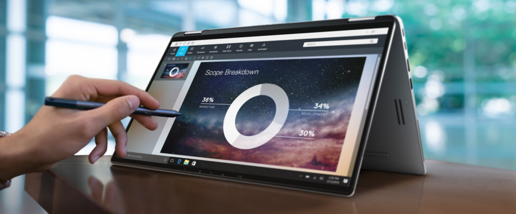Dell Latitude 7400 2-in-1 with touch pen on a touch screen display